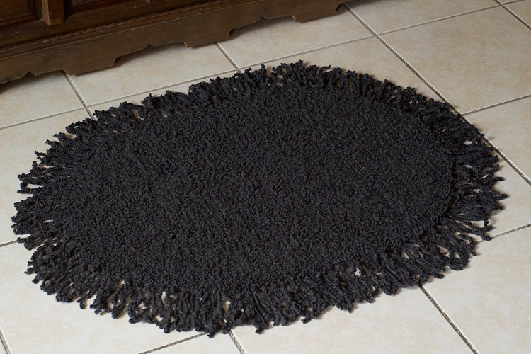 tapis ovale à franges